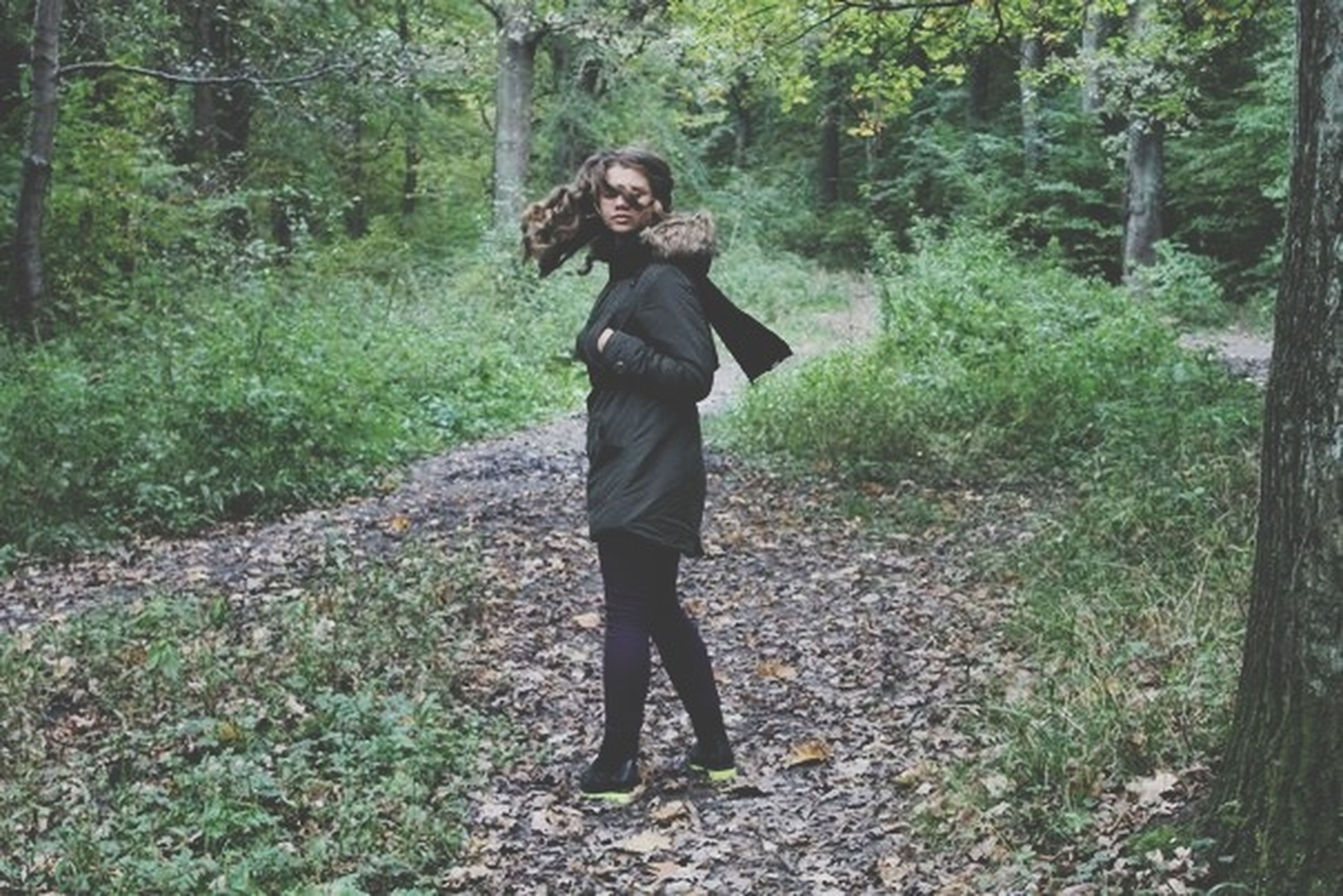 young adult, casual clothing, full length, forest, lifestyles, tree, person, standing, portrait, looking at camera, front view, leisure activity, young women, growth, three quarter length, nature, plant