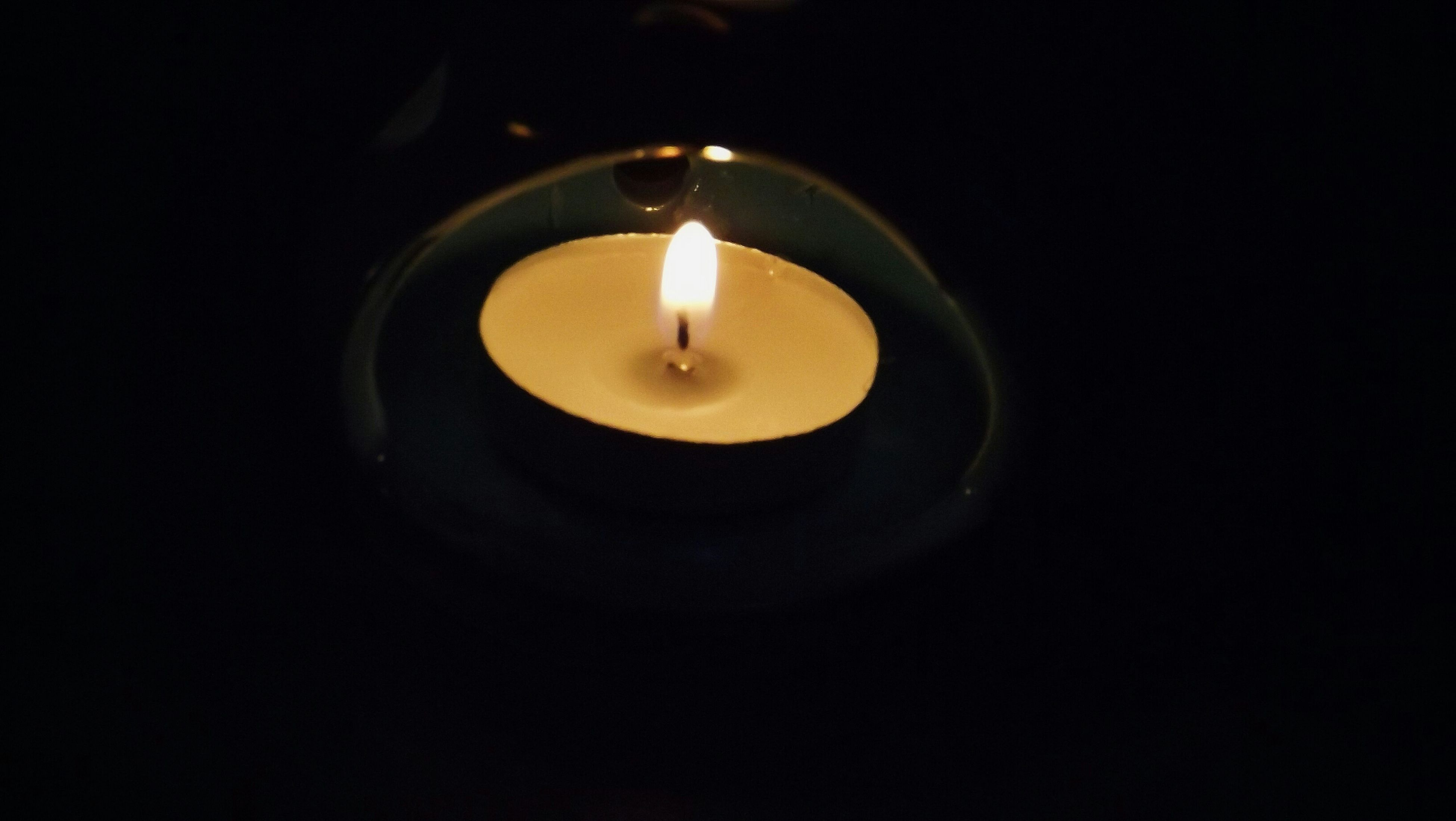 illuminated, lighting equipment, glowing, dark, night, electricity, lit, indoors, copy space, black background, darkroom, studio shot, flame, burning, light - natural phenomenon, electric lamp, light bulb, close-up, lamp, candle