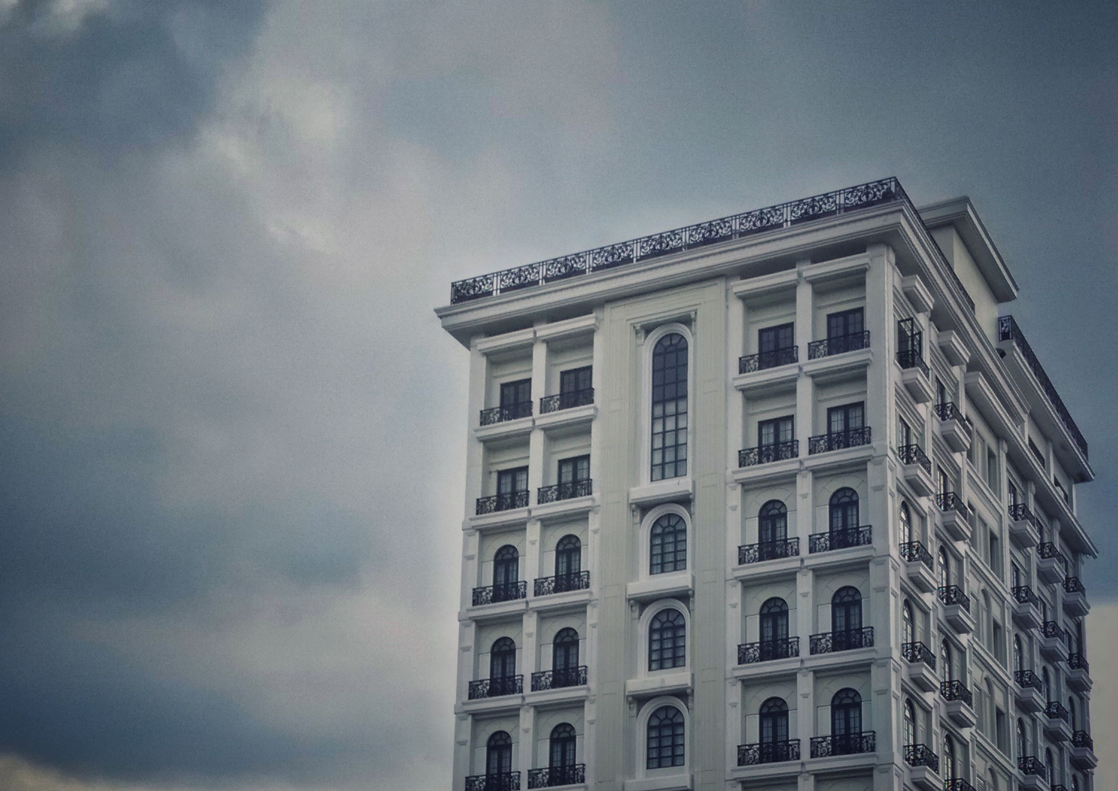 sky, building exterior, low angle view, architecture, built structure, cloud - sky, travel destinations, no people, outdoors, city, day