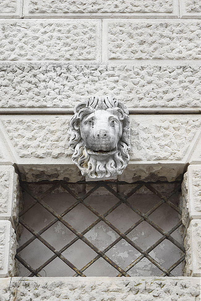 Close-up detail of medieval grill window with marble lion head on top Ancient Architecture Building Exterior Built Structure Close-up Day Façade HEAD Lion Marble Medieval Architecture Metal No People Outdoors Stone Wall Wall - Building Feature Window