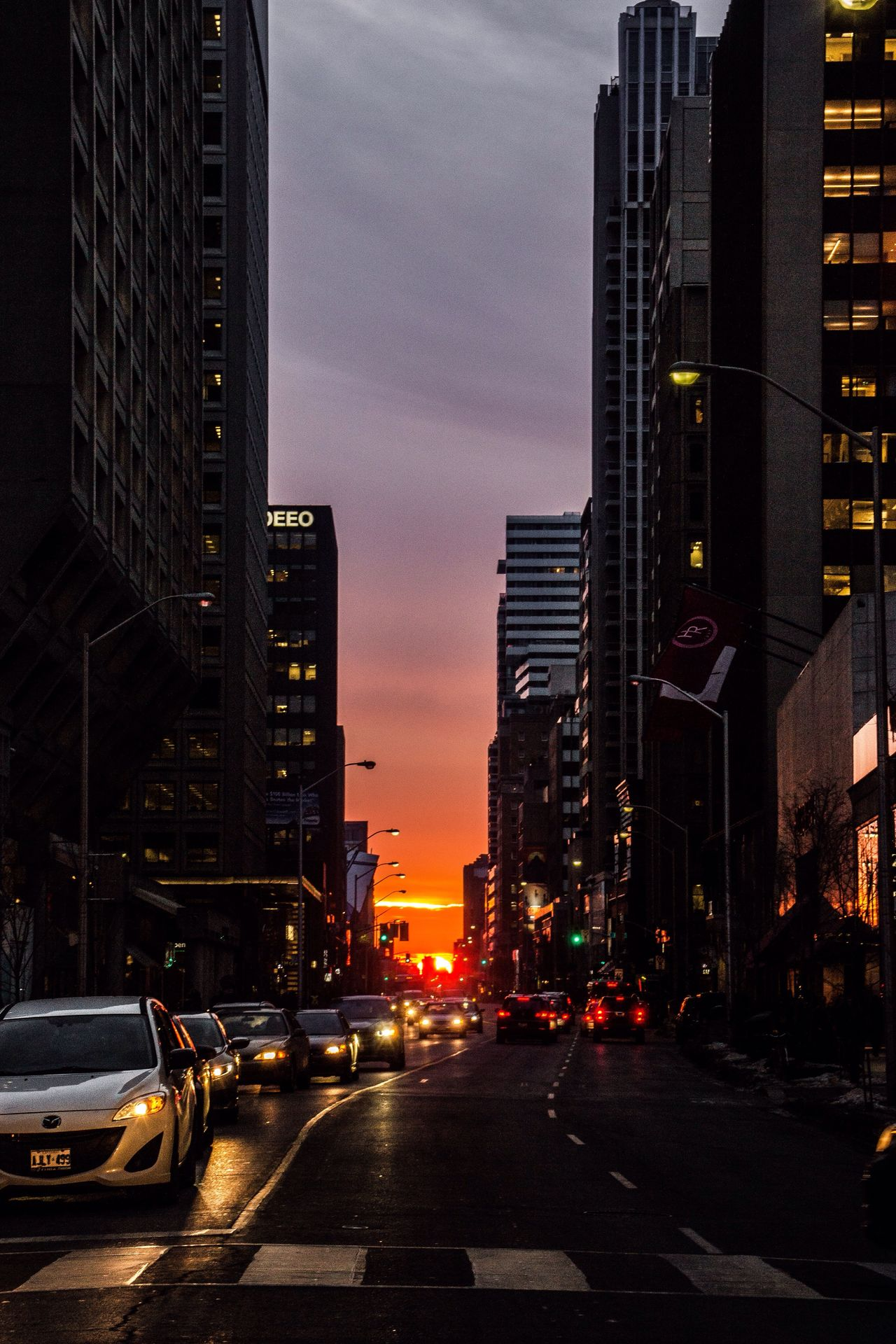 City Architecture Street Building Exterior Road Transportation Traffic Skyscraper Built Structure Car Outdoors Sunset City Life No People Tall Modern Sky Night Red Light