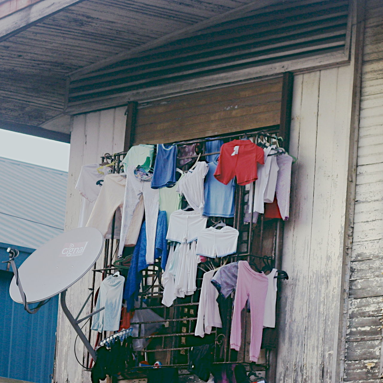 Building Exterior Cloth Clothesline Clothing Drying Hanging House Exterior Laundry Low Angle View Multi Colored No People Outdoors Pattern The Great Outdoors - 2017 EyeEm Awards