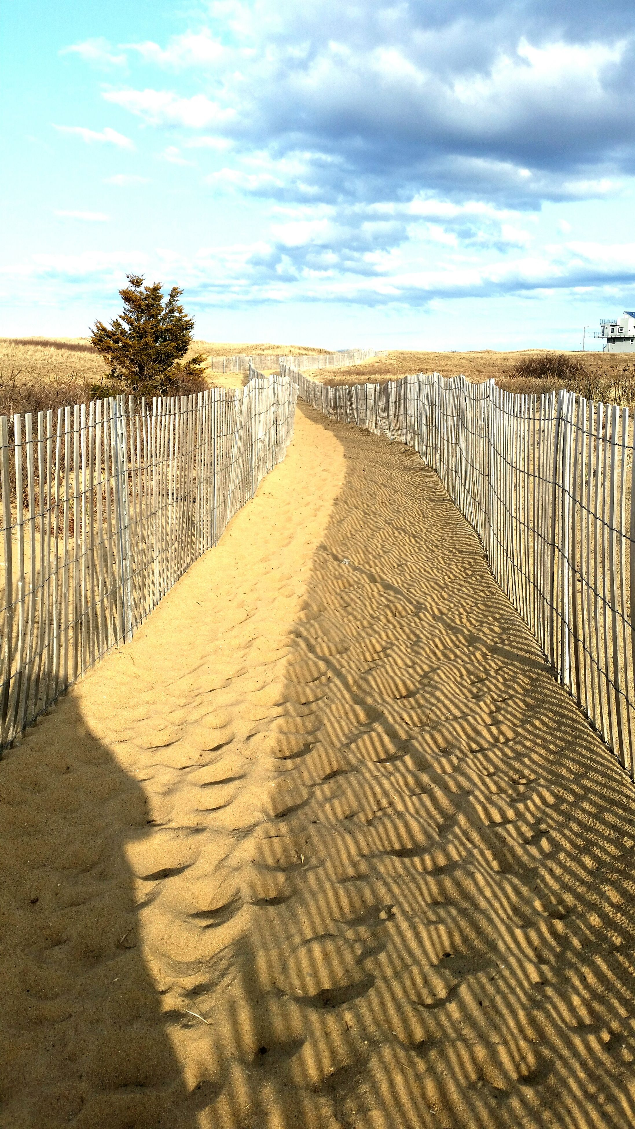 beach, sky, sand, the way forward, sea, tranquility, tranquil scene, horizon over water, diminishing perspective, scenics, shore, water, beauty in nature, nature, cloud - sky, boardwalk, cloud, vanishing point, idyllic, in a row