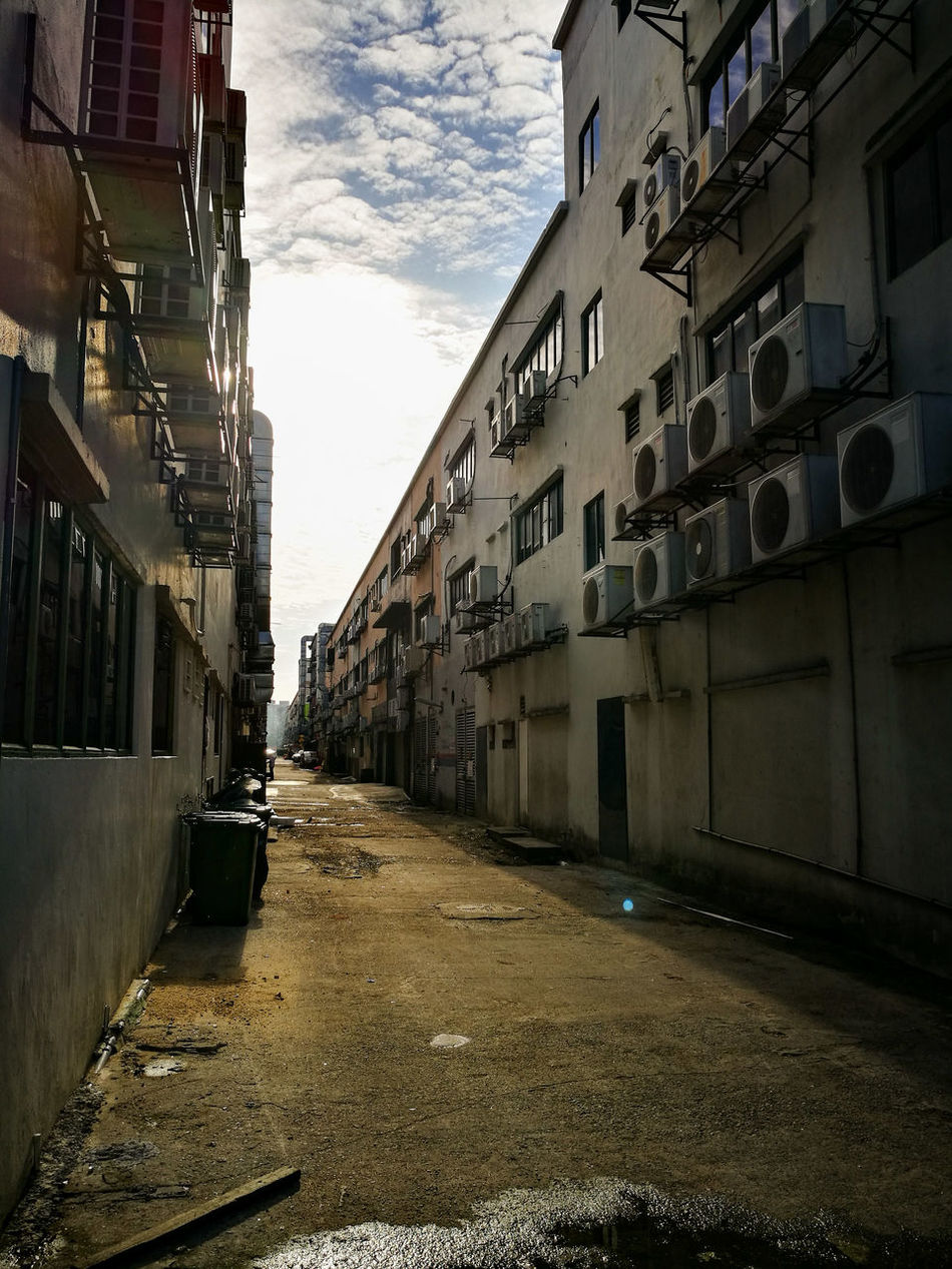 Built Structure Architecture Building Exterior The Way Forward City Residential Building Street Residential Structure Sky Narrow Long Outdoors Diminishing Perspective Day Residential District City Life Empty Road No People Tall - High Office Building