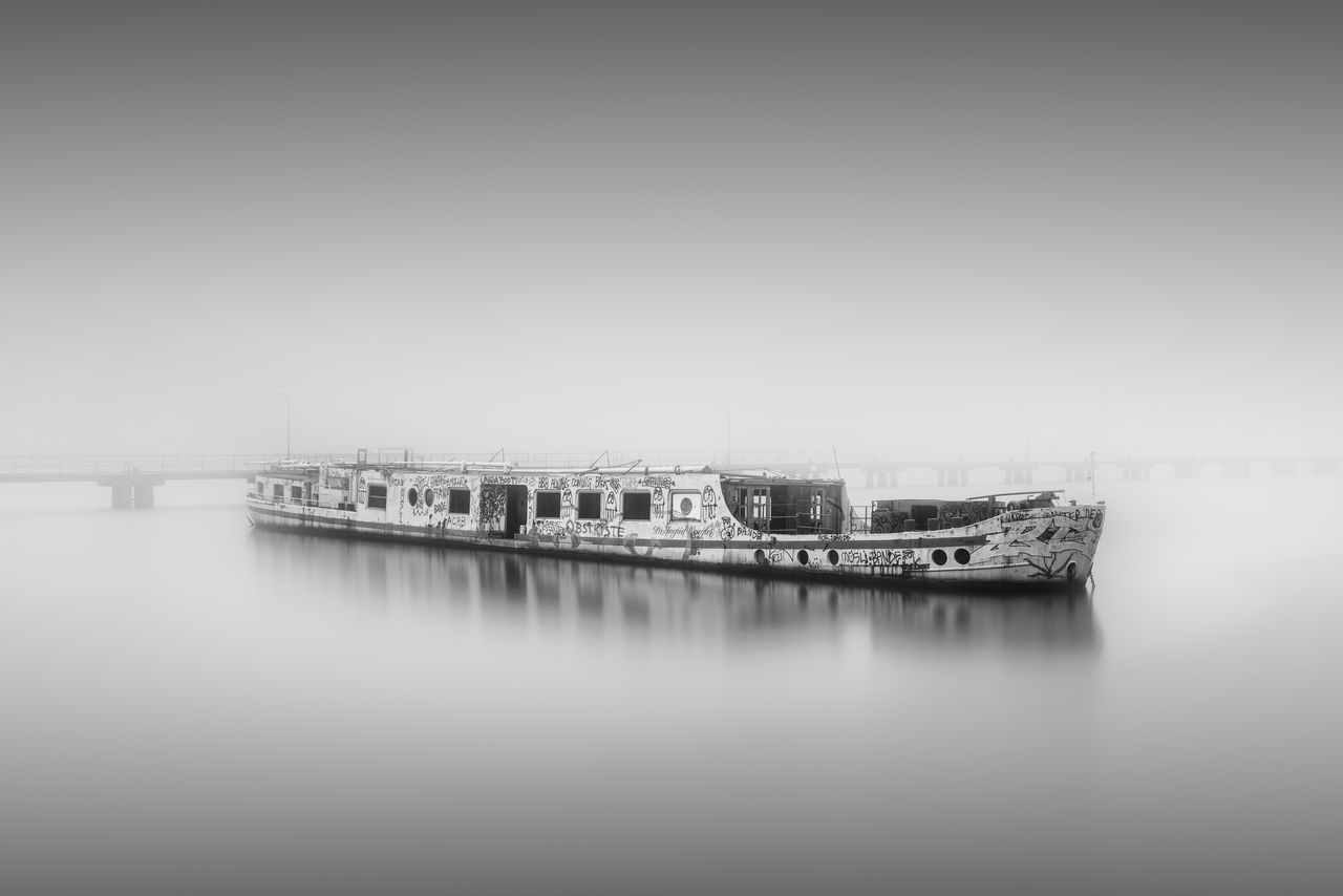 shipwreck over river against foggy surroundings Abandoned Berlin Berliner Ansichten Black And White Bnw Boat City Copy Space Fine Art Foggy Foggy Weather Long Exposure Misty Monochrome Outdoors Philipp Dase Ship Shipwreck Spree River Urbex