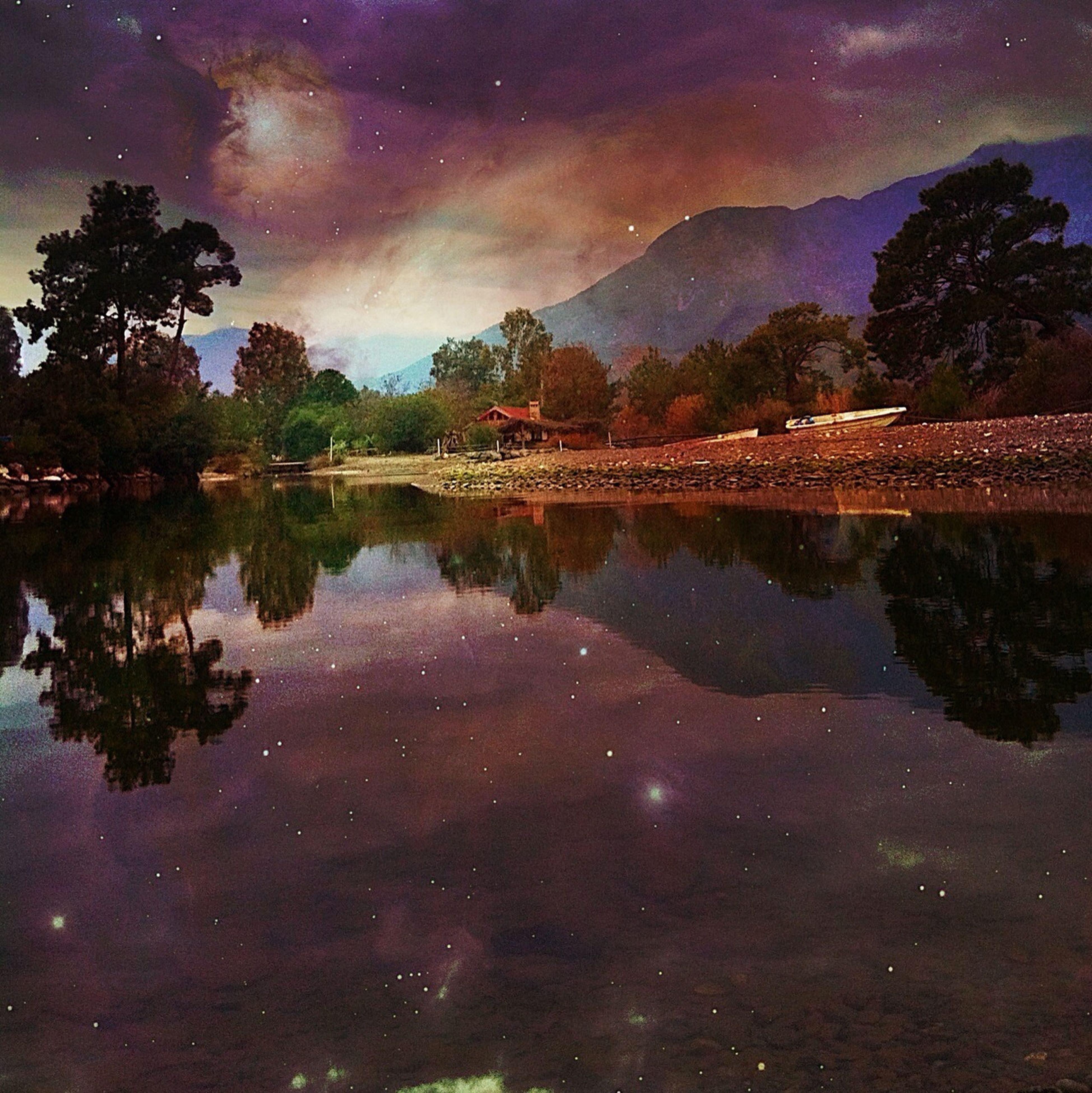 water, reflection, sky, tree, tranquility, tranquil scene, lake, scenics, beauty in nature, cloud - sky, nature, dusk, standing water, idyllic, waterfront, night, illuminated, cloud, river, outdoors