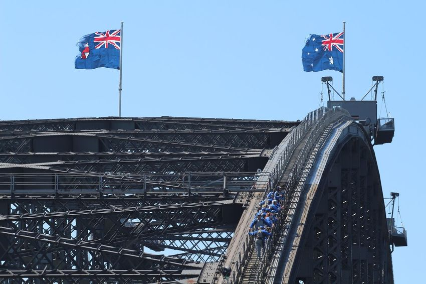 The City Light Flag Patriotism Clear Sky Low Angle View Architecture No People Cultures Built Structure National Icon Day Outdoors Sky Travel Photography Sydney Harbour Bridge Sydney Sydney, Australia Sydney Harbour Bridge Walk