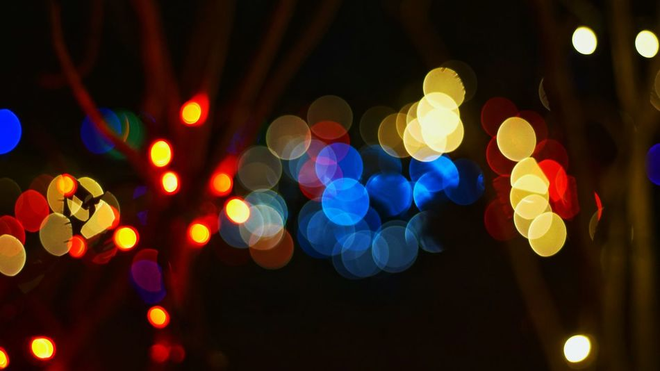 The Culture Of The Holidays Illuminated Night Defocused Lighting Equipment Multi Colored Abstract Light Lens Flare Glowing Light - Natural Phenomenon Circle Dark Outdoors Ideas Electric Light Nightlife Colorful Fairy Lights No People Image Focus Technique Bokeh Photography