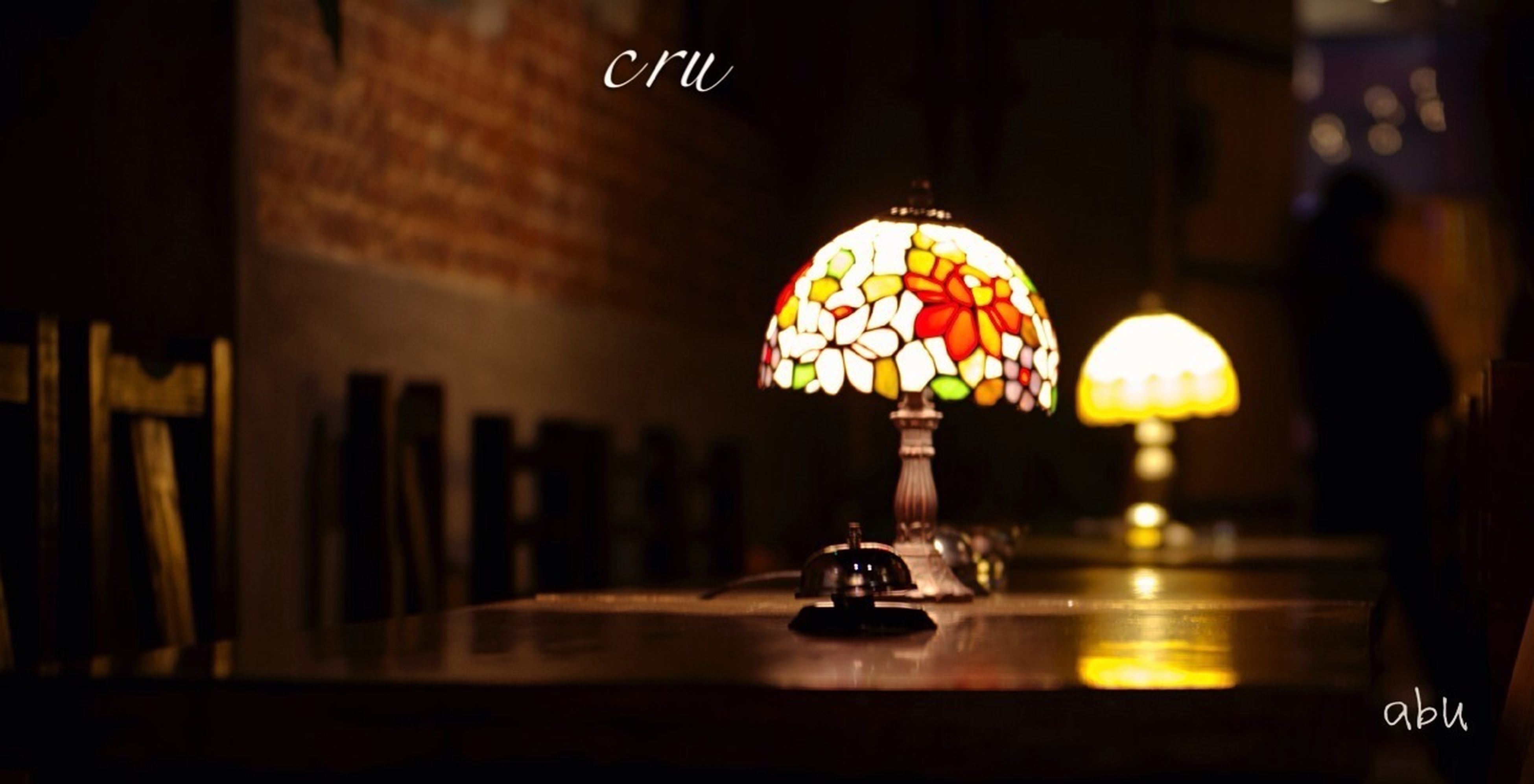 indoors, illuminated, focus on foreground, table, close-up, glass - material, hanging, selective focus, decoration, still life, lighting equipment, religion, no people, reflection, transparent, spirituality, art and craft, home interior, candle