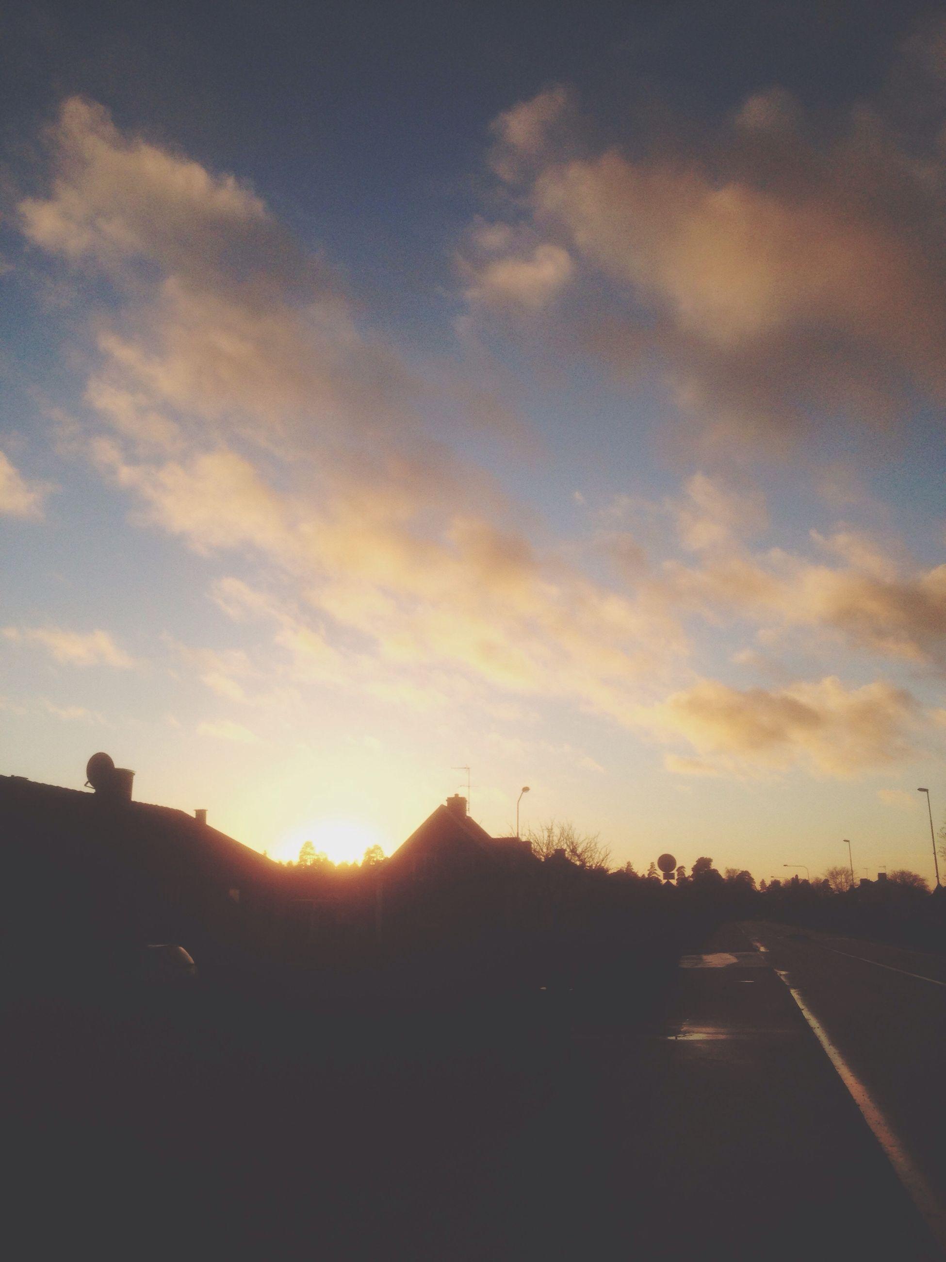 sunset, sky, sun, road, silhouette, scenics, transportation, landscape, tranquility, tranquil scene, sunlight, beauty in nature, cloud - sky, sunbeam, orange color, nature, cloud, outdoors, no people, idyllic
