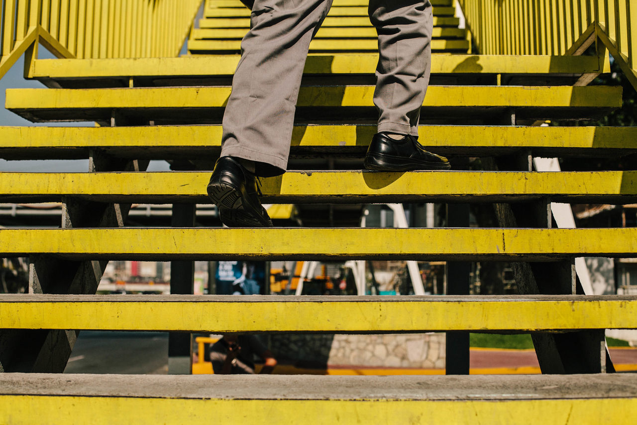Colors day human leg low section one person outdoors real people streetphotography yellow Welcome Weekly Adapted to the City