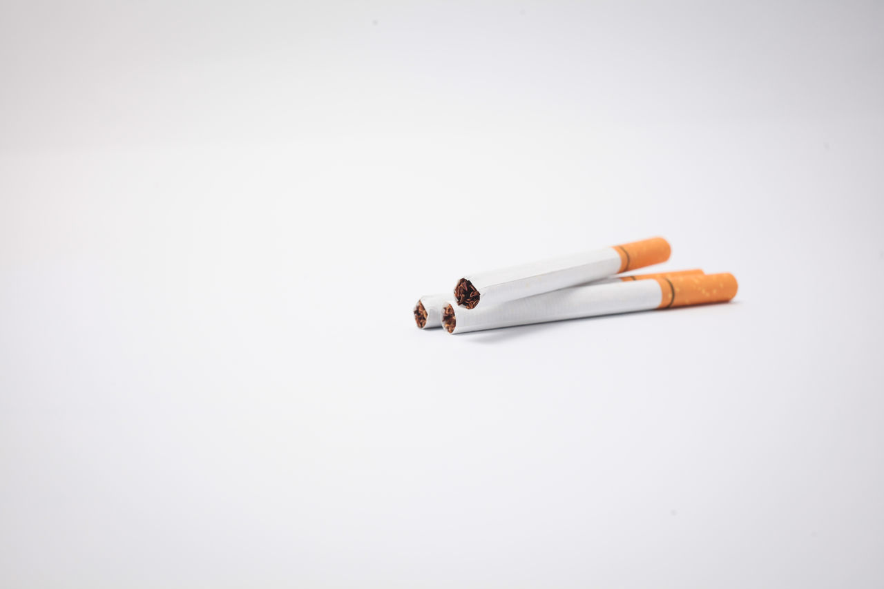 Close-Up Of Cigarettes Over White Background