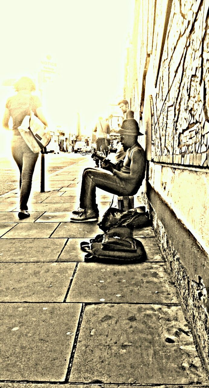 sitting, full length, men, one person, casual clothing, outdoors, day, adult, people, young adult, real people, only men, one man only, adults only, city, chess, musician, sky
