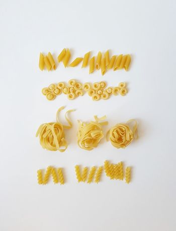 Noodles of all kind White Background Gold Colored Yellow No People Large Group Of Objects Noodles Pasta Healthy Eating Cooking On The Table Freshness Indulgence Food Take A Bite Ingredients Unleavened Dough Variety Of Boiling Water Waves Dinner Real Food Flavors Yummy Arranged Objects