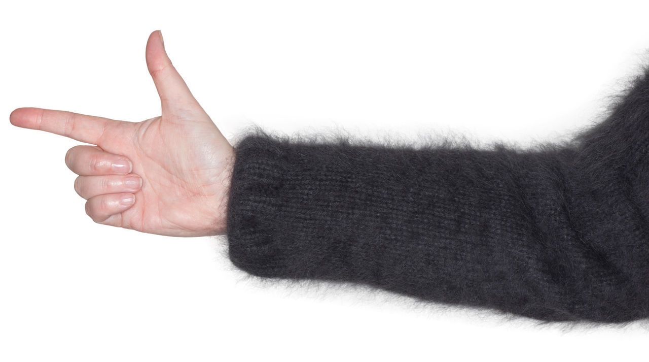 Women hand shows a gesture as a sign language Angora Sweater Angora Wool Arm Attractively Body Part Concept Exemptly Finger Fist Flawlessly Forefinger Gesture Human Body Parts Human Hand Point Portrait Sign Sign Language Snugly Stretching Symbol Thumb Woman Women Hand Wool