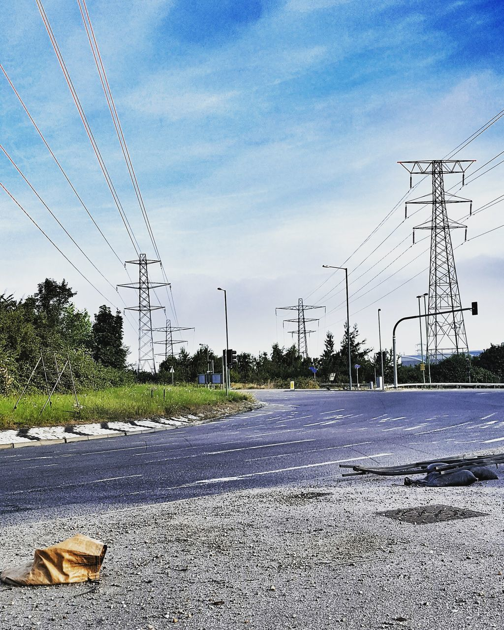 cable, electricity pylon, electricity, power line, power supply, fuel and power generation, connection, sky, road, no people, transportation, day, technology, outdoors, landscape, tree, nature, telephone line