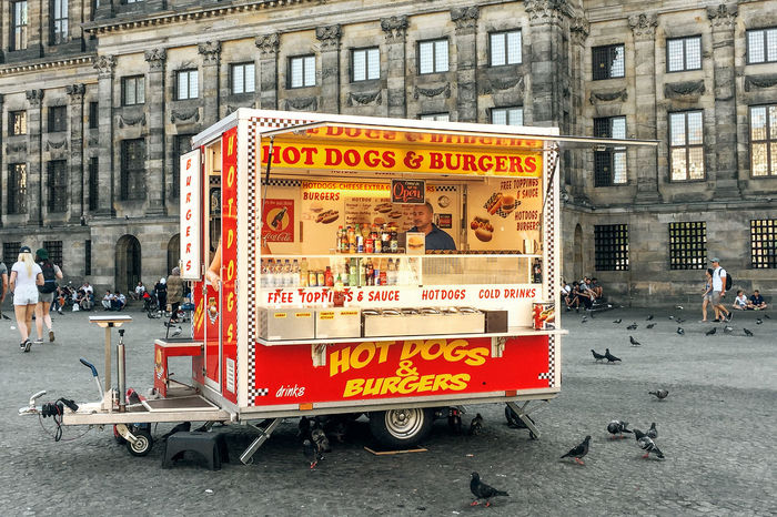 Fast Food Hot Dogs Man Square Working Architecture Bird Built Structure Burgers Day Food Food Truck Historical Museum Outdoors Plaza