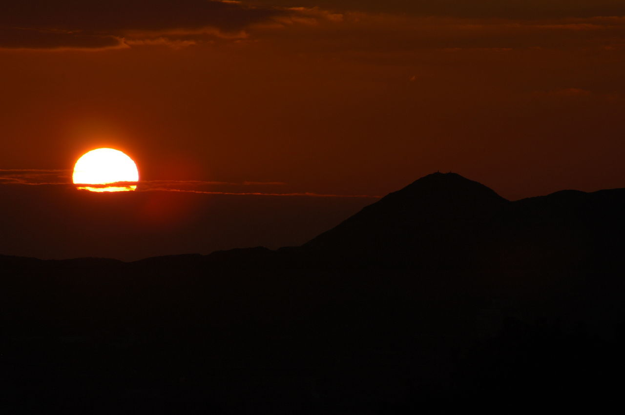 Dawn over Edinburgh. Silhouette of Arthur's Seat Silhouette Beauty In Nature Sky Tranquility Dark Cloud - Sky Outline Sun Edinburgh Scotland Dawn Of A New Day