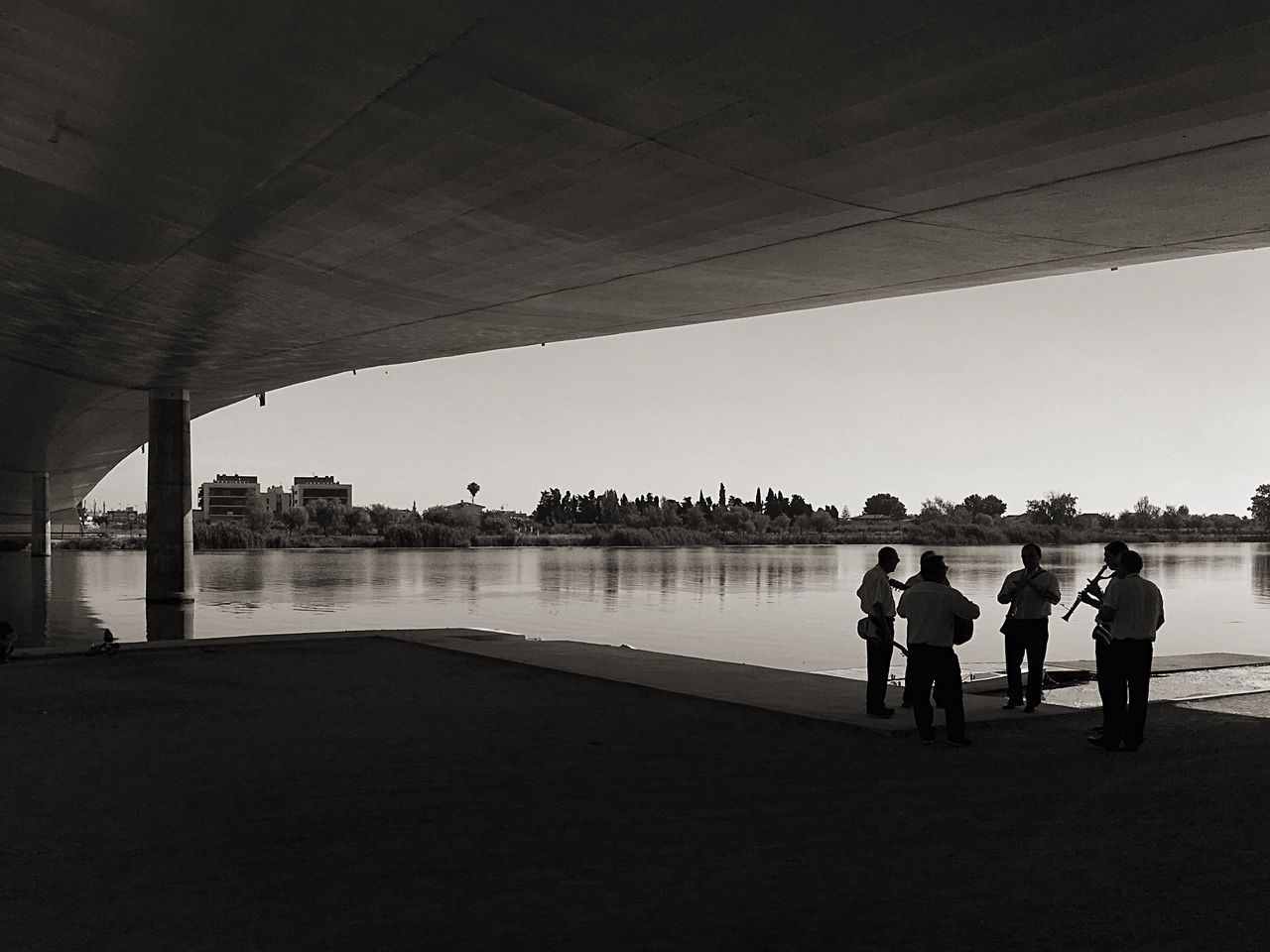 Bridge - Man Made Structure Delta De L'Ebre Musician Connection Full Length Real People Built Structure Architecture River Water Togetherness Below Lifestyles Standing Friendship Day Under Outdoors Men Clear Sky Sky Underneath The Architect - 2017 EyeEm Awards