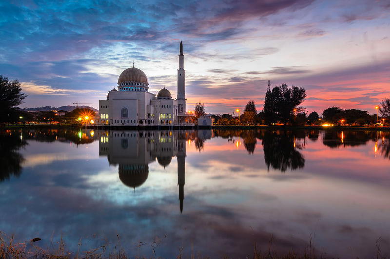 Floating mosque Architecture Building Exterior Built Structure Cloud - Sky Dome Floating Mosque Illuminated Islam Islamic Architecture Lake Mosque Place Of Worship Reflection Religion Scenics Sky Spirituality Sunset Symmetry Tourism Tranquility Travel Destinations Water Waterfront