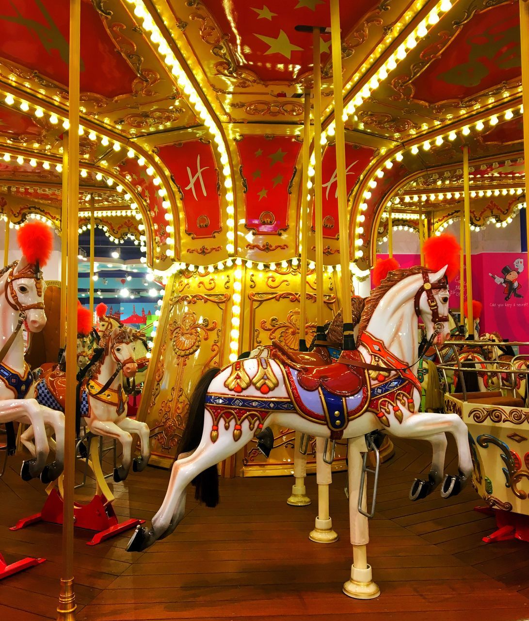 arts culture and entertainment, amusement park, carousel, carousel horses, amusement park ride, horse, leisure activity, animal representation, enjoyment, fairground ride, recreational pursuit, merry-go-round, fun, illuminated, side view, turning, night, excitement, childhood, no people, multi colored
