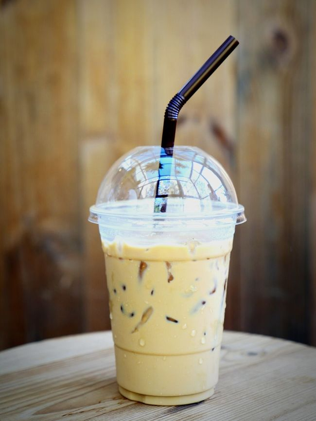 Drinking Straw No People Drink Drinking Glass Close-up Freshness Refresh Caffeine Relax Beverage Take Away Cups Plastic Cup Latte Ice Cafeteria Cafe Ice Coffee Coffee Table Indoors  Wooden Brown