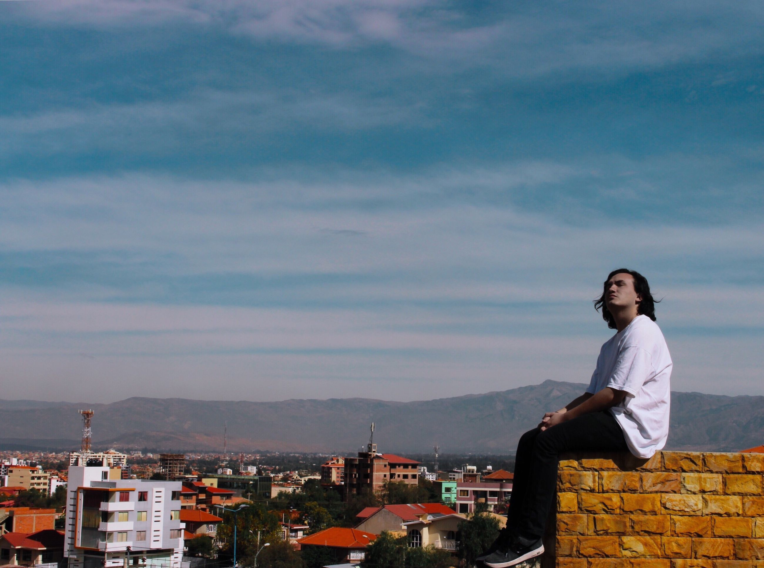 architecture, built structure, cloud - sky, building exterior, real people, sky, lifestyles, one person, outdoors, young women, cityscape, young adult, day, city