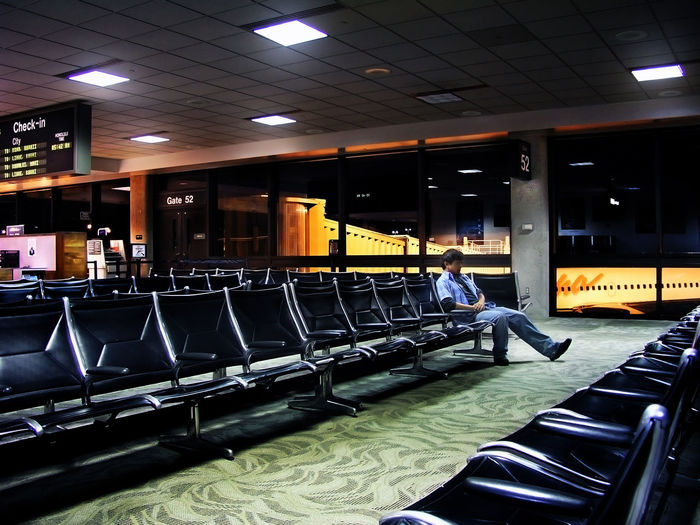 5:30 am, waiting to board a plane not due for another three hours. Heading from Hawaii back to California. I thought I was moving here to stay. Three weeks later, after constant browbeating i was told to leave. i had prepared for a year for this, and was bitter for over a year afterward at the friend who flew me over, swearing to never speak to him again. I ran into him at Ikea one afternoon, a mile away from my home in Orange County. For a moment i wanted to read him the riot act. We hugged and forgave instead. Airport Waiting Airport Lounge Honolulu Airport Depressed Alone Airport At The Airport Airportphotography Predawn
