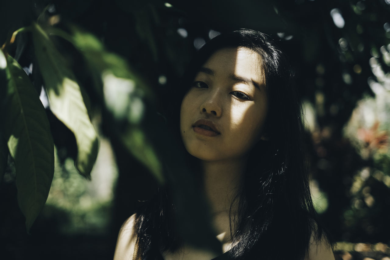 Light and Shadows Beautiful Woman Beauty In Nature Black Hair BYOPaper! Close-up Day Focus On Foreground Front View Headshot Nature One Person Outdoors Portrait Portrait Of A Woman Real People The Portraitist - 2017 EyeEm Awards Tree Tree Trunk Young Adult Young Women