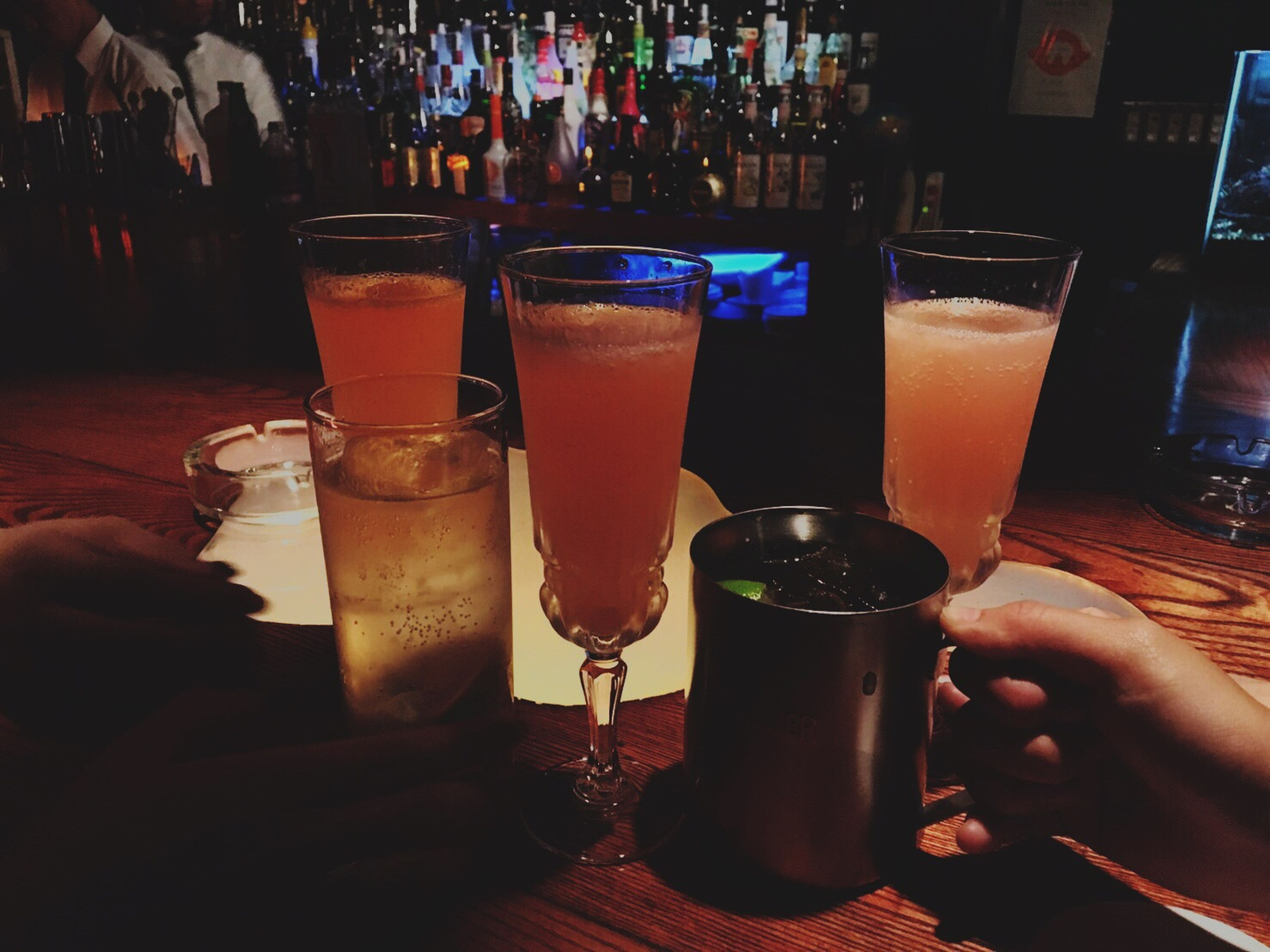drink, food and drink, refreshment, table, drinking glass, alcohol, freshness, men, lifestyles, person, holding, beer glass, restaurant, bar - drink establishment, beverage