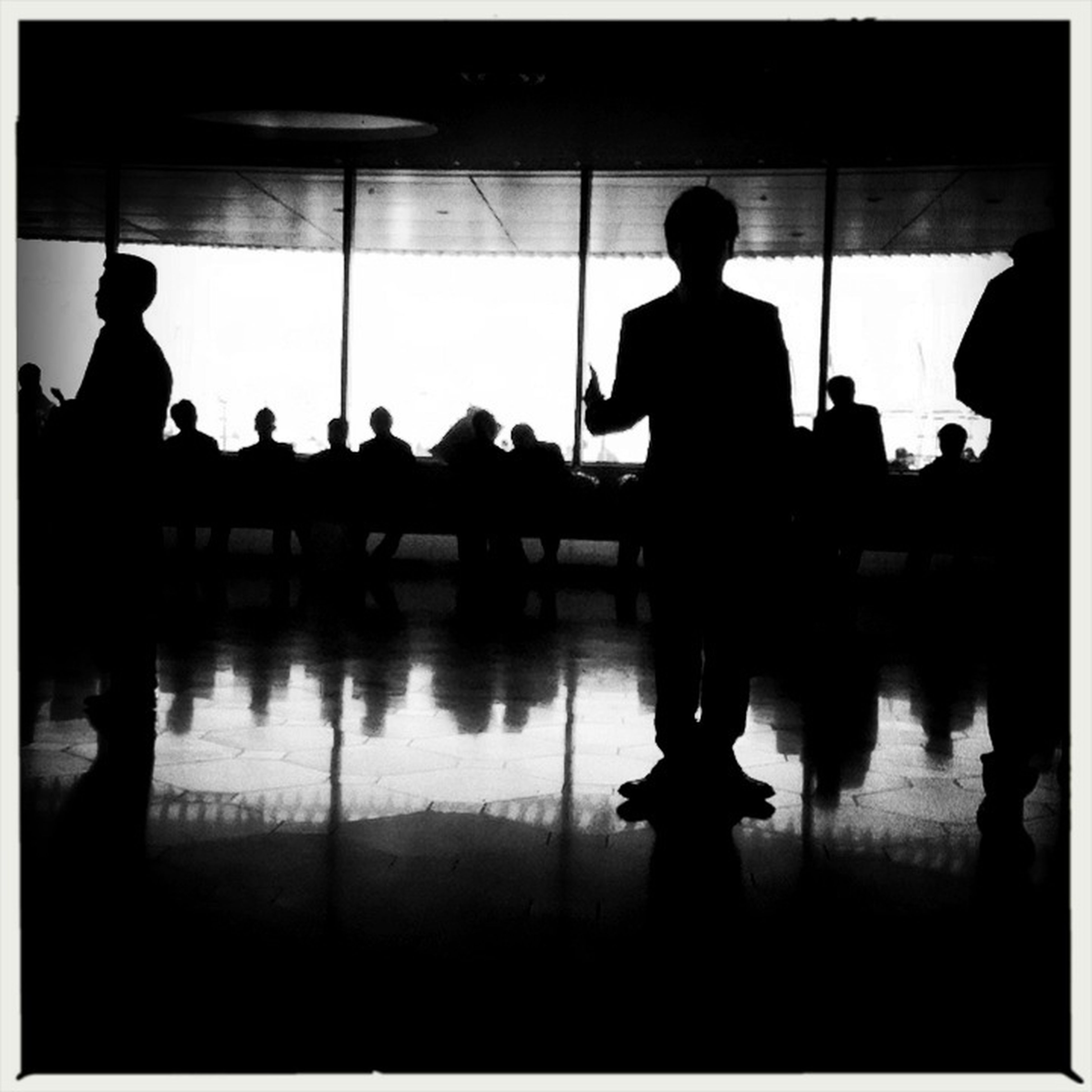 silhouette, men, indoors, transfer print, lifestyles, standing, reflection, auto post production filter, person, walking, full length, leisure activity, outline, rear view, illuminated, built structure, unrecognizable person