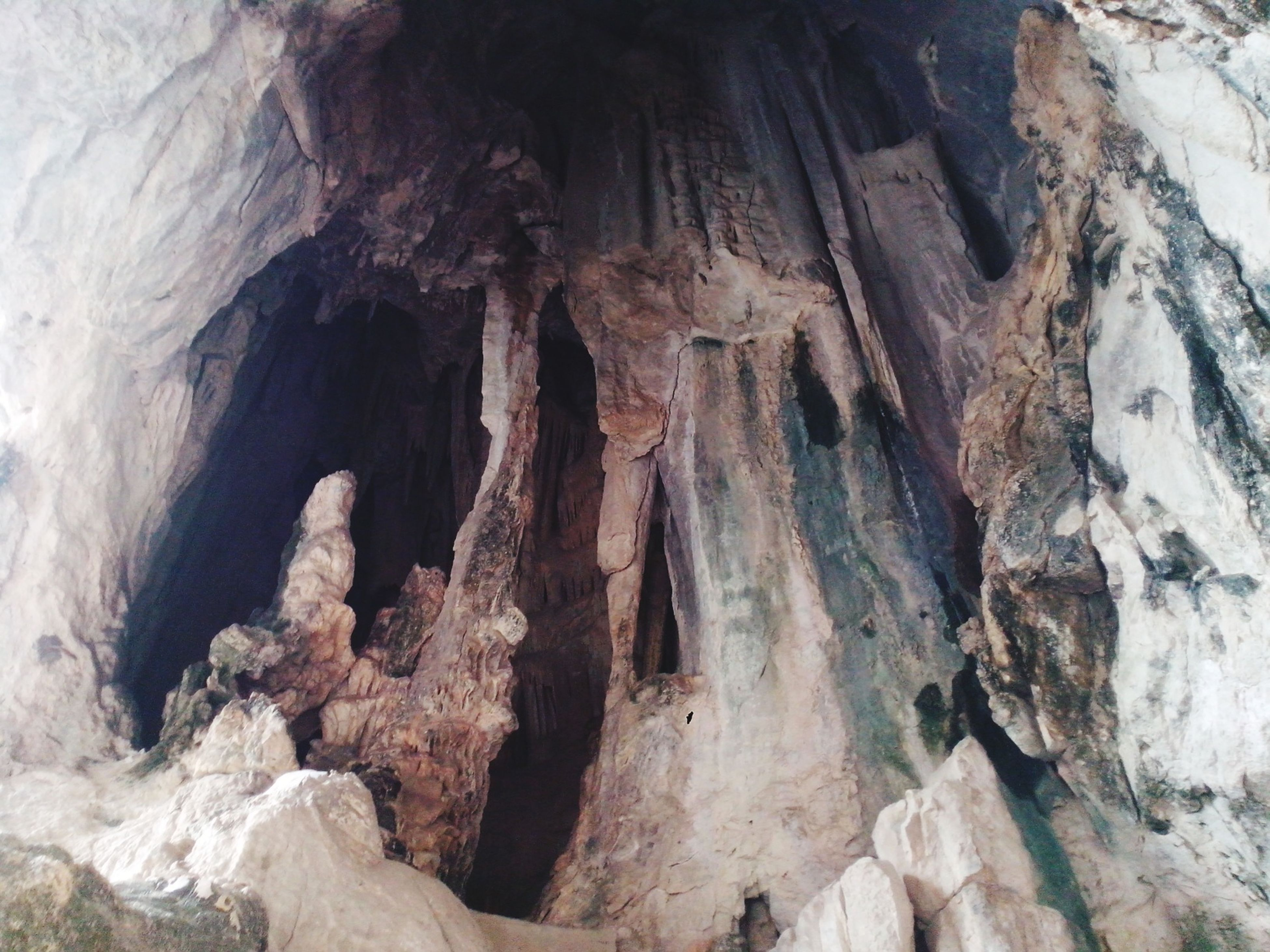 rock formation, rock - object, geology, rough, textured, eroded, rock, physical geography, nature, rocky, cave, rugged, natural pattern, tranquility, rocky mountains, beauty in nature, low angle view, no people, day, outdoors