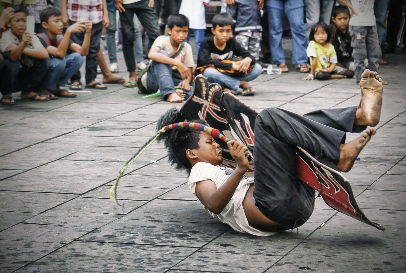 "Street Performance... Kuda Lumping (Flat Horse), a Traditional Javanese Dance. Dancer ""rides"" a horse made from woven bamboo and decorated with colorful paints. There is a type of Kuda Lumping Performance incorporates trances and magic tricks... Humaninterest Human Interest"