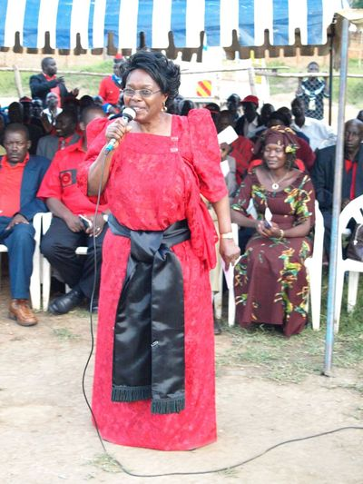 The first ugandan First Lady: Miria Obote Casual Clothing City Life Day First Lady Uganda Full Length Leisure Activity Lifestyles Miria Obote Outdoors Portrait Sitting Traditional Clothing