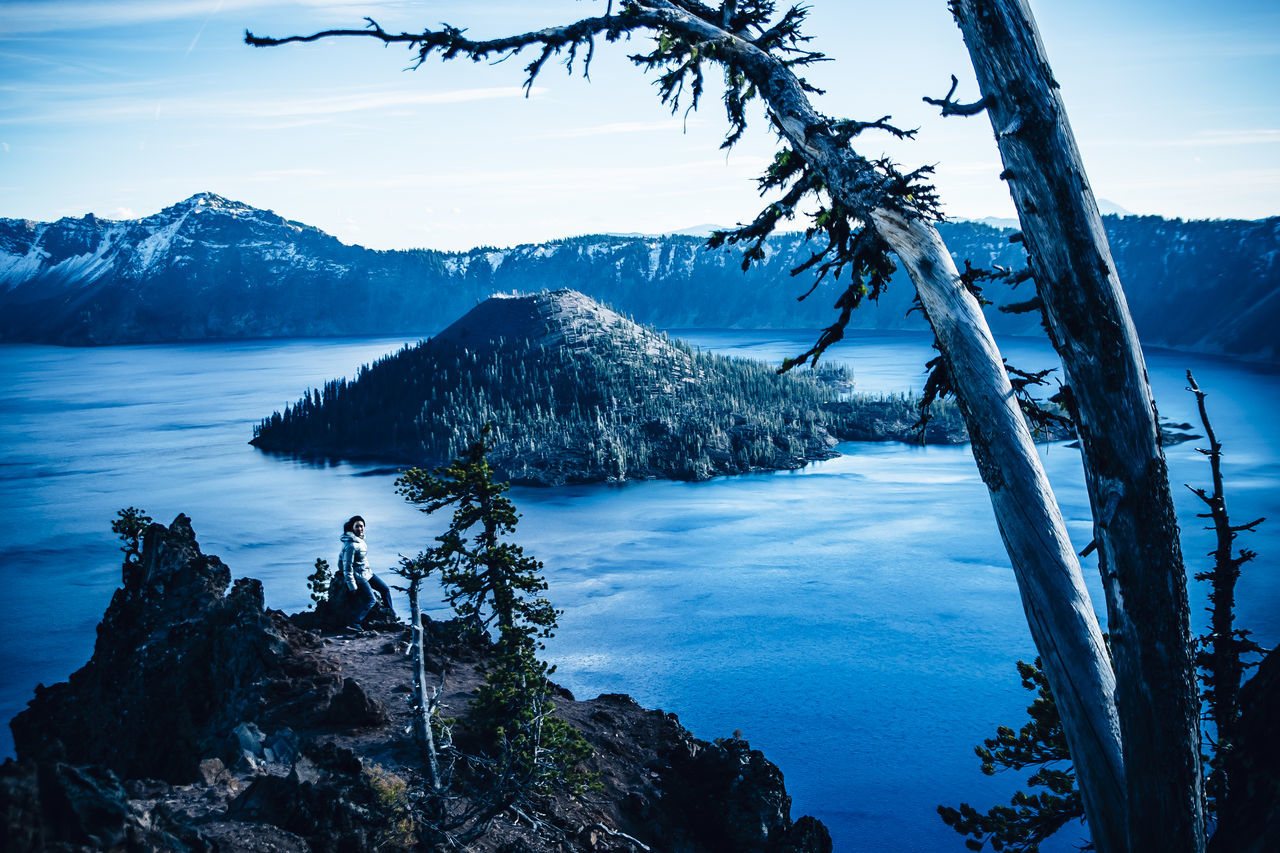Crater Lake, Oregon. The deepest and bluest lake in the U.S Beauty In Nature Beauty In Nature Blue Cold Crater Lake Crater Lake National Park Deepest Lake In The US Dusk Lake Landscape Mountain Nature Nature One Person Oregon Outdoors Reflection Sky Snow Sunset Volcano Winter Woman Young Adult TCPM The Great Outdoors - 2017 EyeEm Awards