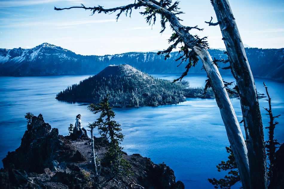Crater Lake, Oregon. The deepest and bluest lake in the U.S Beauty In Nature Beauty In Nature Blue Cold Crater Lake Crater Lake National Park Deepest Lake In The US Dusk Lake Landscape Mountain Nature Nature One Person Oregon Outdoors Reflection Sky Snow Sunset Volcano Winter Woman Young Adult TCPM
