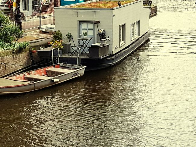 Nautical Vessel Canal Moored Building Exterior Transportation Mode Of Transport Architecture Water Day No People Outdoors Rowboat Travel Destinations Gondola - Traditional Boat Amsterdam Amsterdam Canal Cityscape Vacations Sunlight Travel Photography Travelling