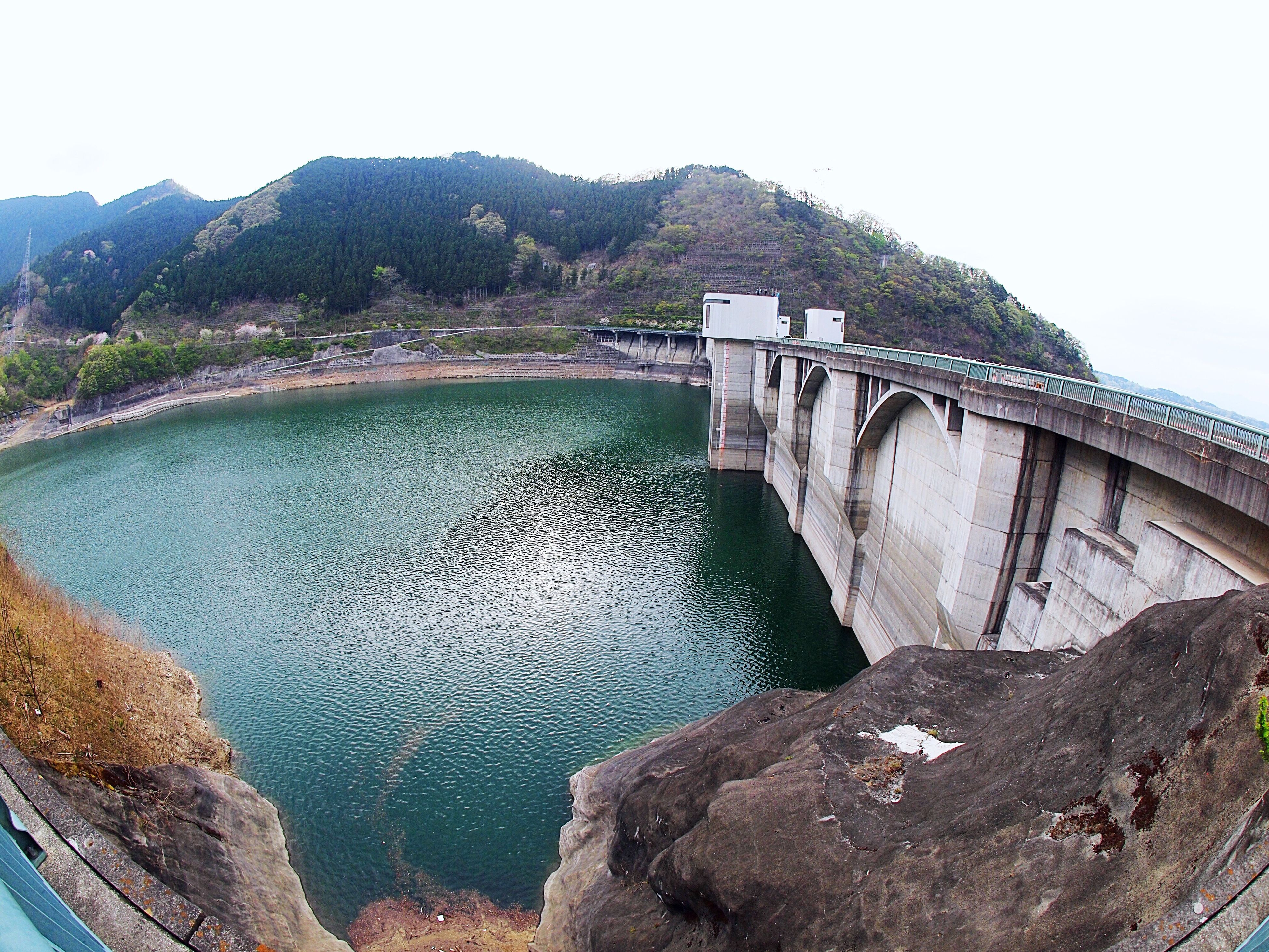 hydroelectric power, dam, water, mountain, bridge - man made structure, fuel and power generation, renewable energy, engineering, river, built structure, architecture, outdoors, day, nature, connection, no people, scenics, mountain range, alternative energy, water conservation, power station, beauty in nature, travel destinations, sky, clear sky, irrigation equipment