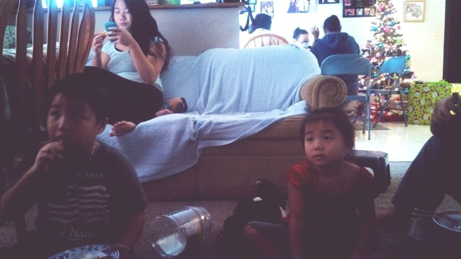 These kids watching The Polar Express and eating!