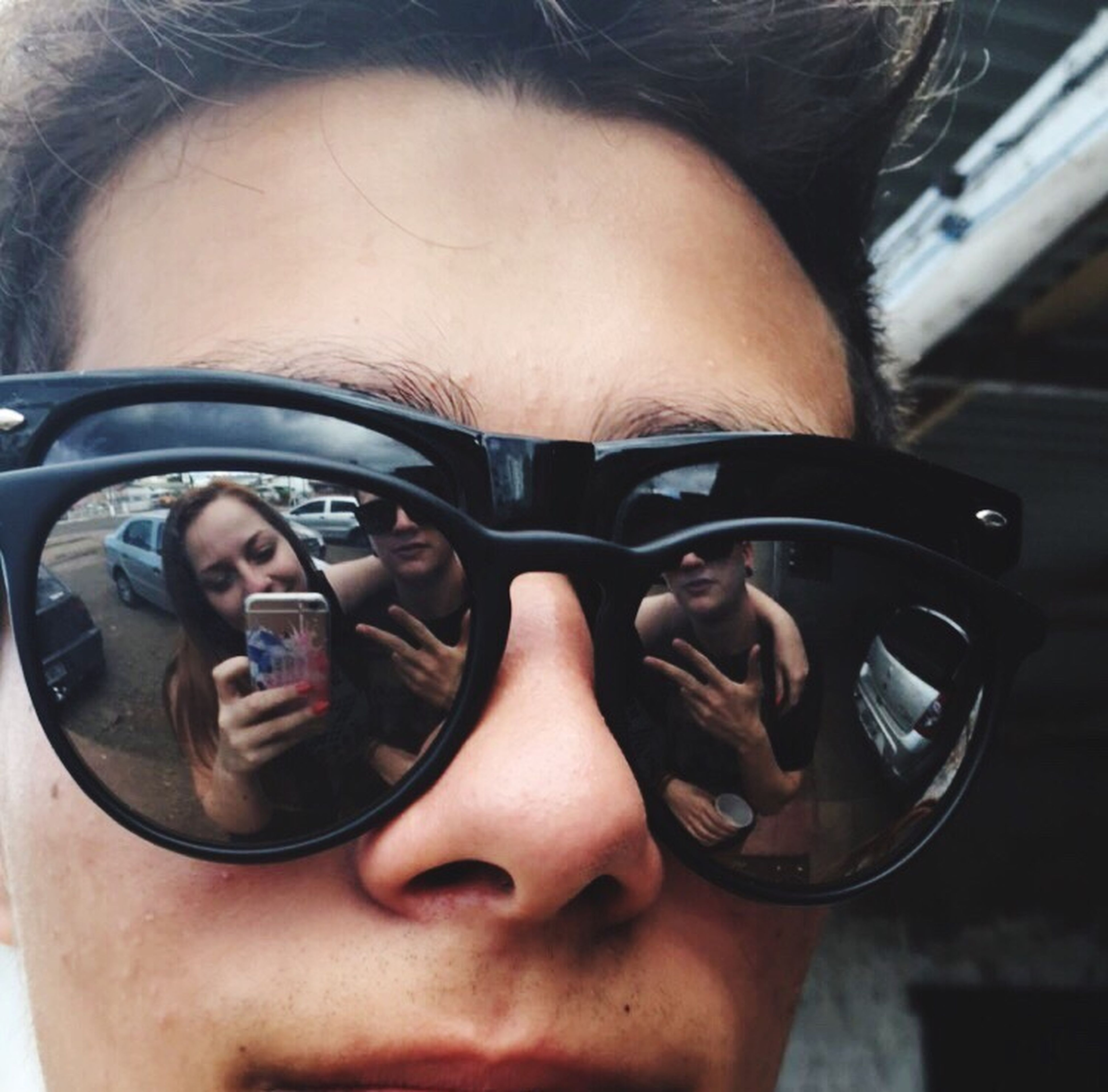 lifestyles, holding, person, leisure activity, close-up, part of, indoors, headshot, sunglasses, cropped, car, young adult, food and drink, front view, men, focus on foreground