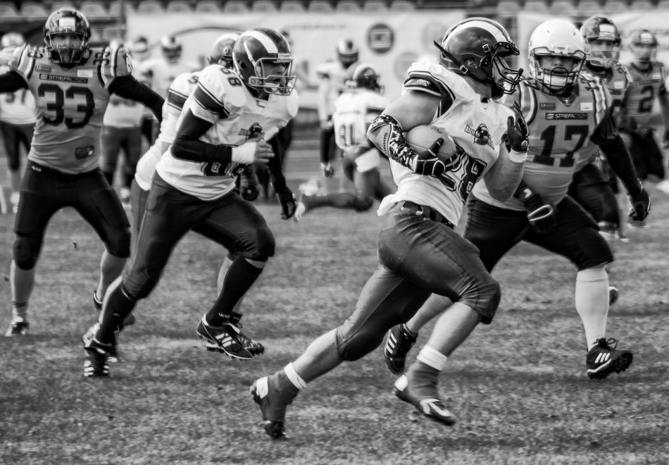Adult American Football - Ball American Football - Sport American Football Field American Football Player American Football Team American Football Uniform Competition Competitive Sport Day Football Helmet Men Outdoors People Running Sports Clothing Sports Team Sportsman