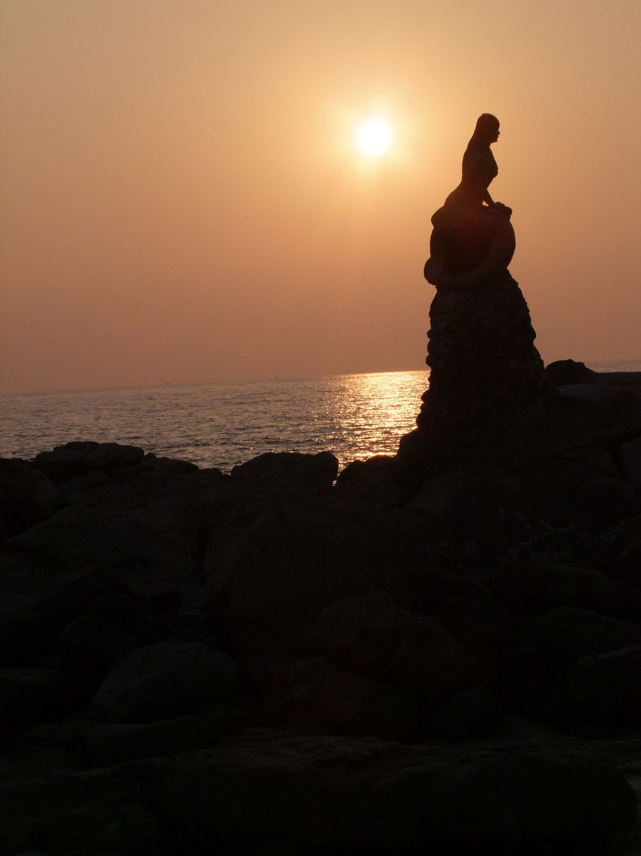 Mermaid on the Rocks at Sunset Beach Beauty In Nature Beauty In Nature Composition Full Frame Mermaid Statue Myanmar Nature Ngapali Ngapali Beach No People Orange Sky Sunset Outdoor Photography Reflection In The Water Rock - Object Sea Silhouette Statue Sunset Tourist Attraction  Travel Destination Water Yellow Sun Yellow Sunset Zen-like