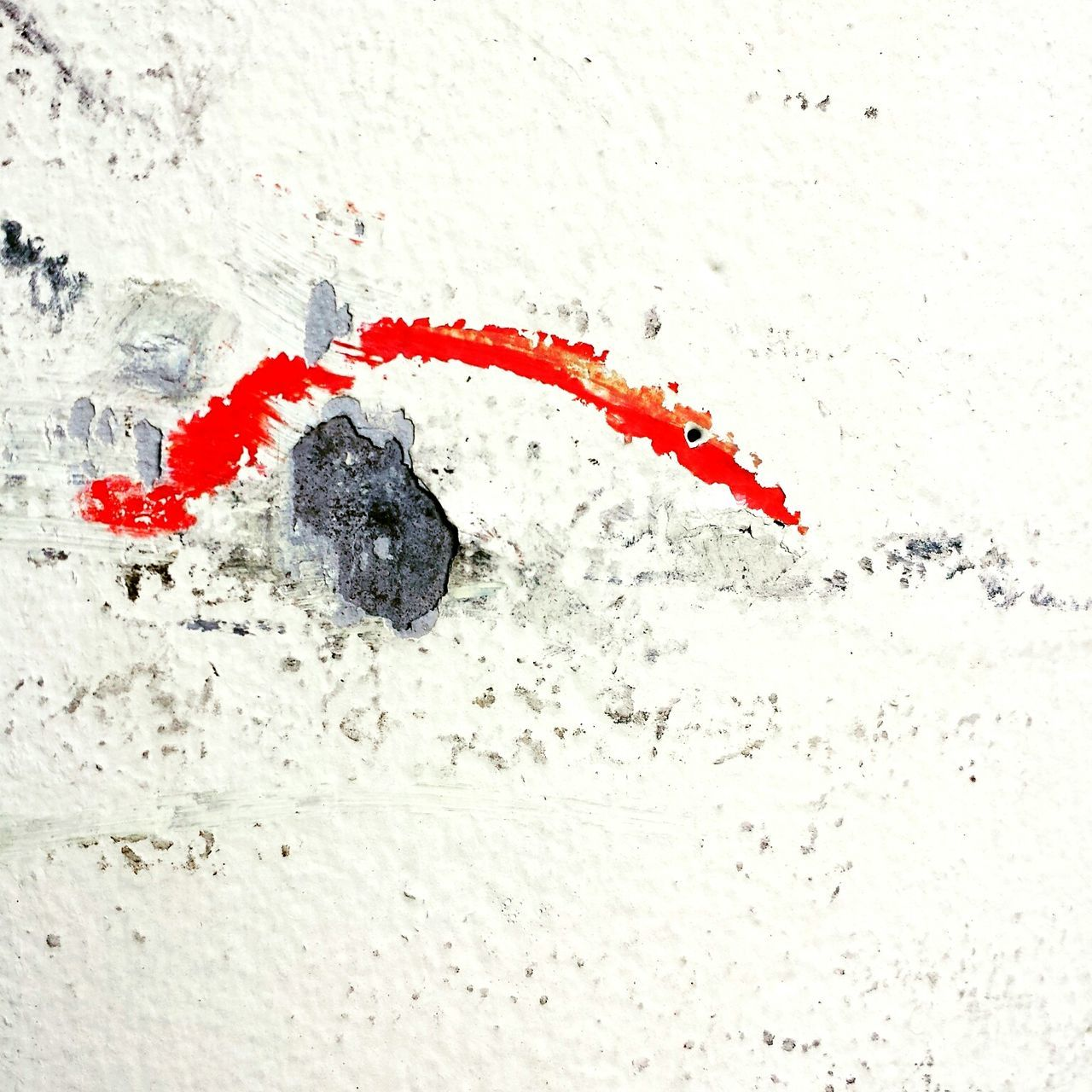 Close-Up Of Red Paint On Old Wall