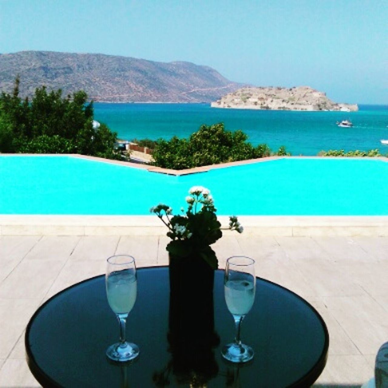 Enjoying the view of Spinalonga island from Elounda Beauty In Nature Scenics Blue Water Sea Outdoors Having A Good Time Landscape Summer Vacations Friends
