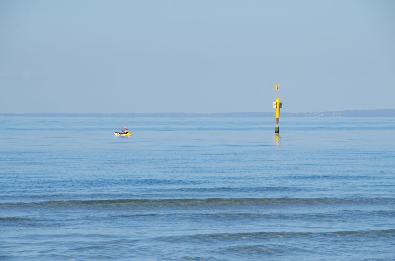 water, sea, blue, nature, beauty in nature, waterfront, day, scenics, horizon over water, outdoors, tranquility, tranquil scene, leisure activity, real people, clear sky, extreme sports, adventure, sky