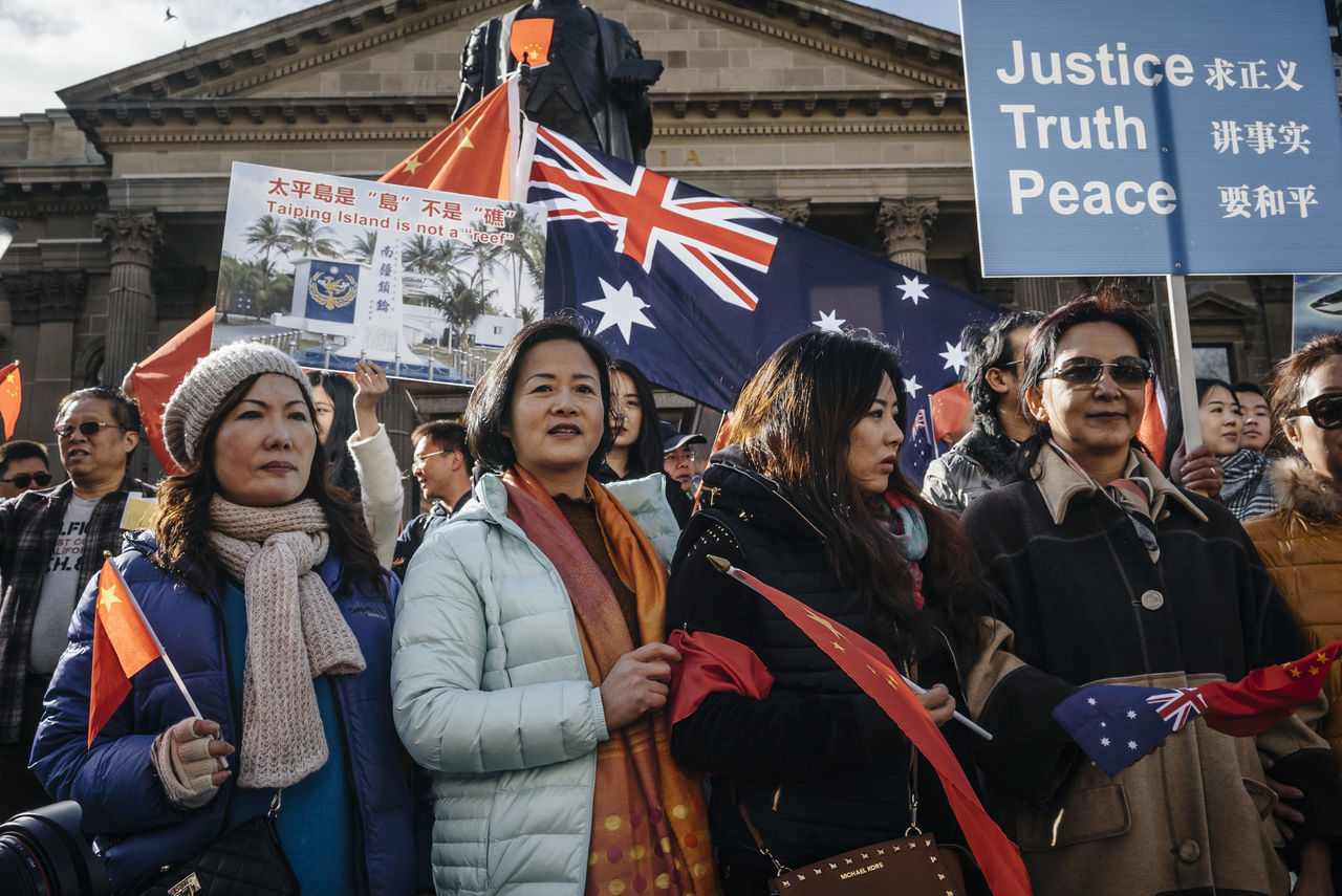 """On 23 July 2016 in a rarely occur protest, hundreds of Australian Chinese marched through the city of Melbourne to protest an international tribunal ruling against China's actions in the South China Sea. The groups are calling on the Australian government to maintain its policy of """"not taking sides"""" in the escalating territorial and diplomatic stoush. Australia Melbourne MelbournePhotographer Outdoors Peaceful Protest Photojournalism Political Protest Rally Reportage Sony Australia SonyA7s South China Sea Dispute Streets Of Melbourne VSCO"""