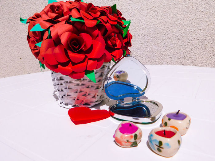 Simple and white Beautiful Candles EyeEmNewHere Mirror Simple Things In Life Basket Basket Of Flowers 🌷 Close-up Day Decoration Decorations Decorative Flowers Fragility Heart High Angle View No People Phone Case Red Roses Simple Simplicity Table White White Background