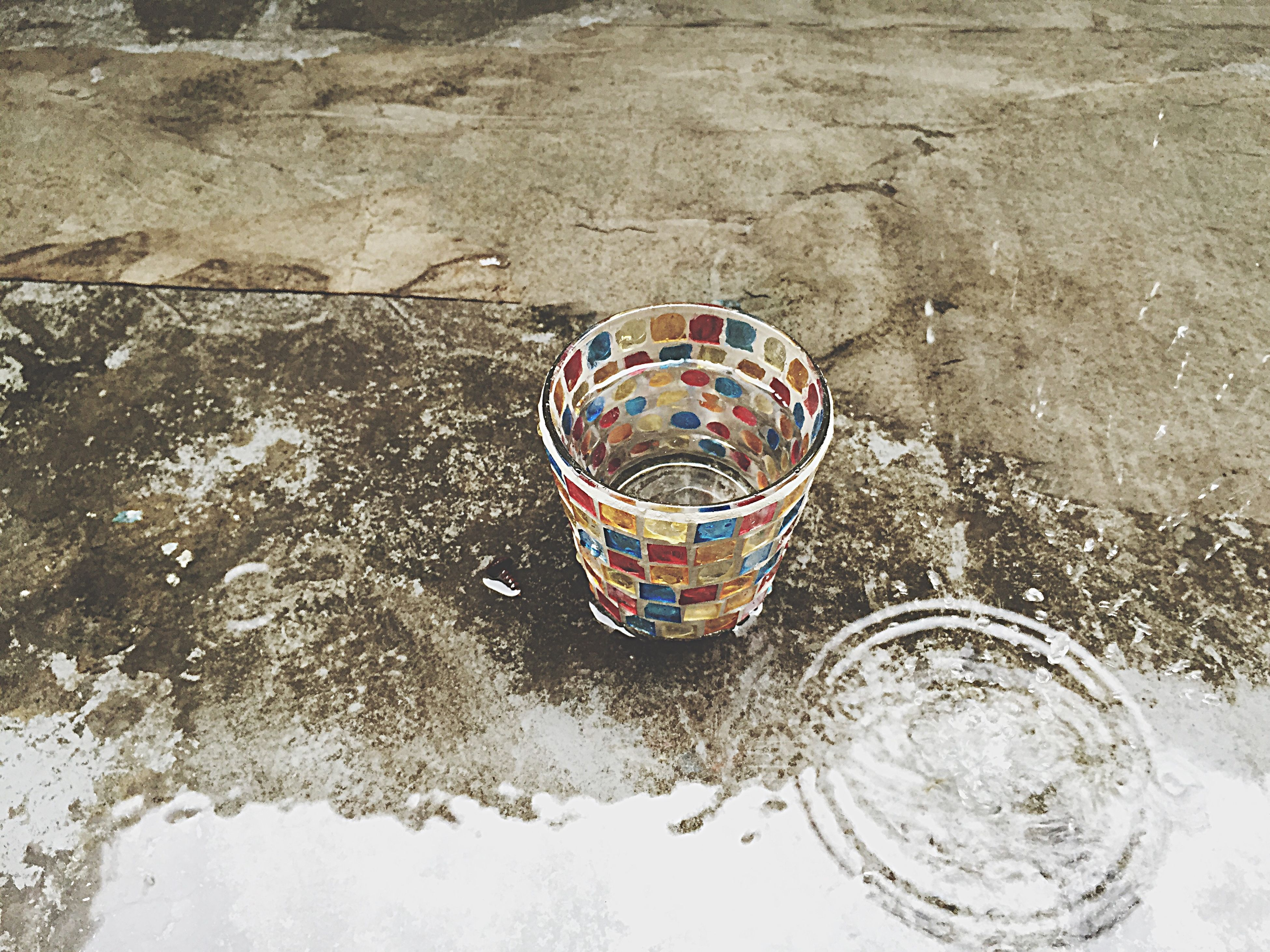 water, high angle view, multi colored, reflection, circle, day, no people, outdoors, waterfront, close-up, blue, nature, pattern, directly above, rock - object, transportation, rippled, bicycle, motion, single object