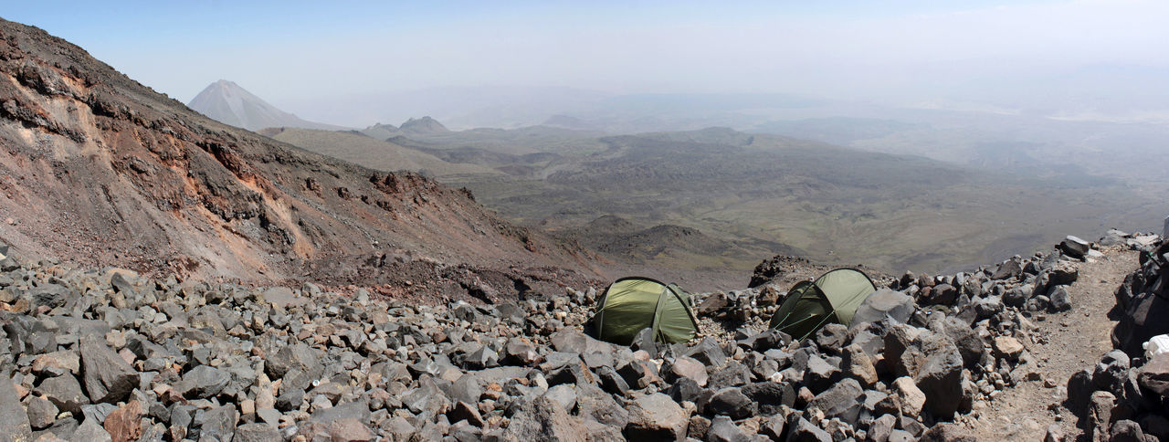 Panoramic view of two lonely tents near the high camp at mount Ararat with Kücük Agri Dagi (Small Ararat) in the background, Agri Province; Turkey Camping High Hiking Mountaineering Panorama Panoramic Path Wandering Adventure Ararat  Ağrı Dağı Camp Landscape Mountain Outdoors Pathway Rocks Scenery Scenics Summit Tent Tents Trail Volcano Way