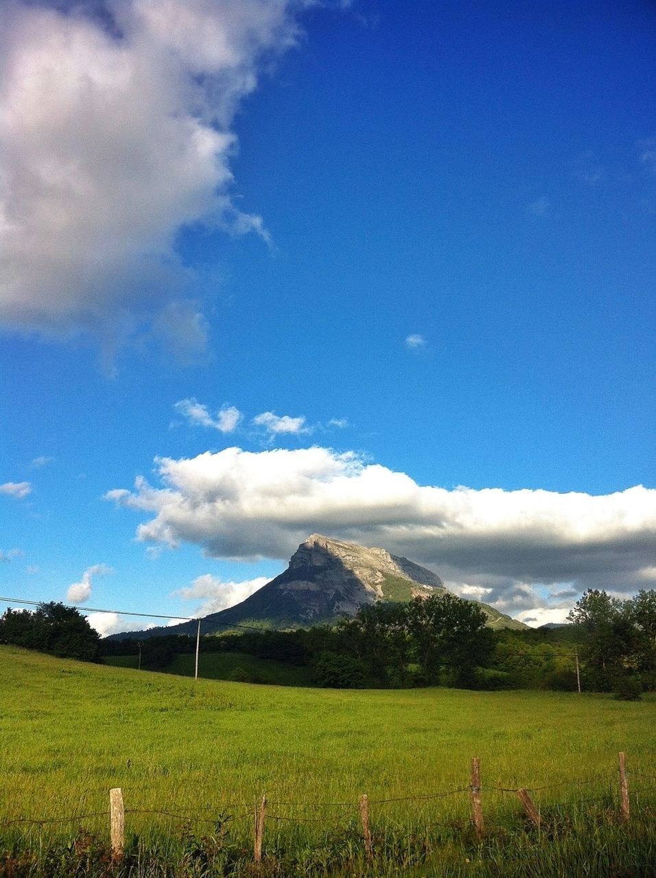Countryside landscape with mountain peak against the sky